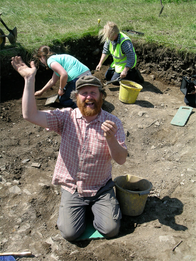 Cliadhbh Ó Gibne (famed Donore boat builder) just after he discovered the Bective double spiral pin.