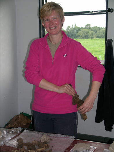 Bone expert, Fiona Beglane, showing the hip bone is connected to the leg bone.