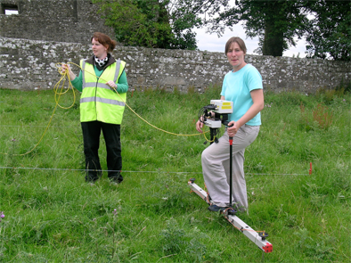 Joanna Leigh shows IAFS student Joanna Kavanagh the intricacies of geophysical survey.