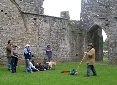 Kevin O'Brien explains the intricacies of architectural survey to the IAFS students in the Cloister of Bective Abbey