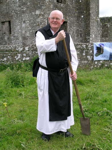 Father Augustine, Abbot of New Mellifont Abbey, turns the ceremonial first sod.