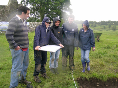 Despite the rain, an intrepid team carries out more survey.